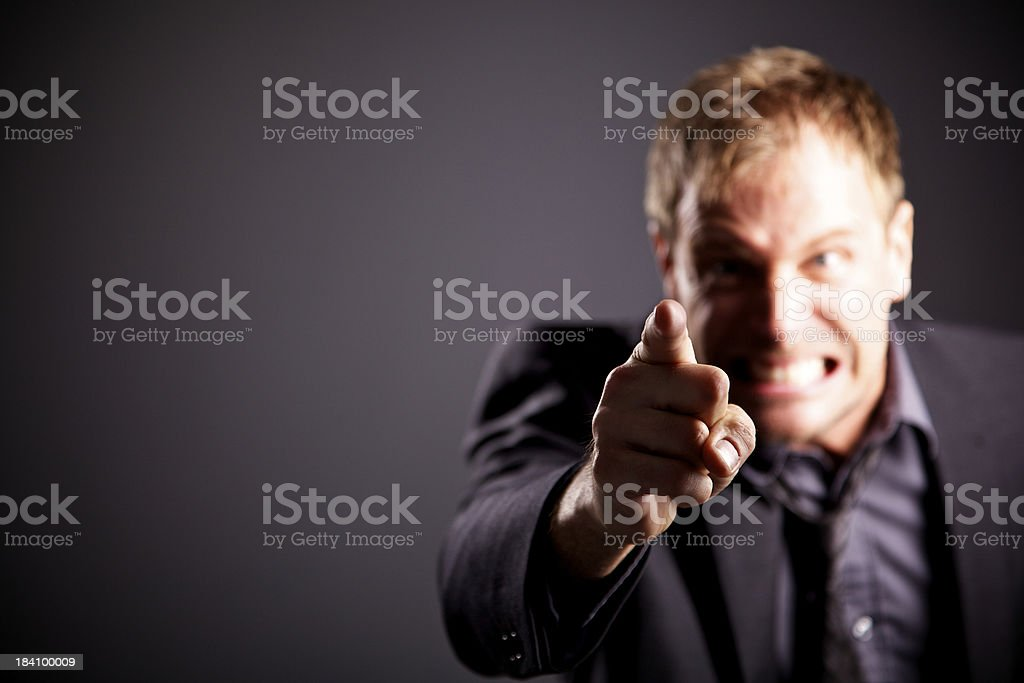 pointing angry  business men stock photo