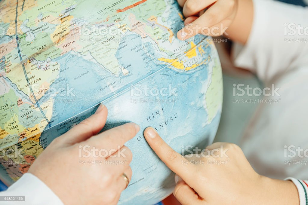 Pointing at a Globe stock photo