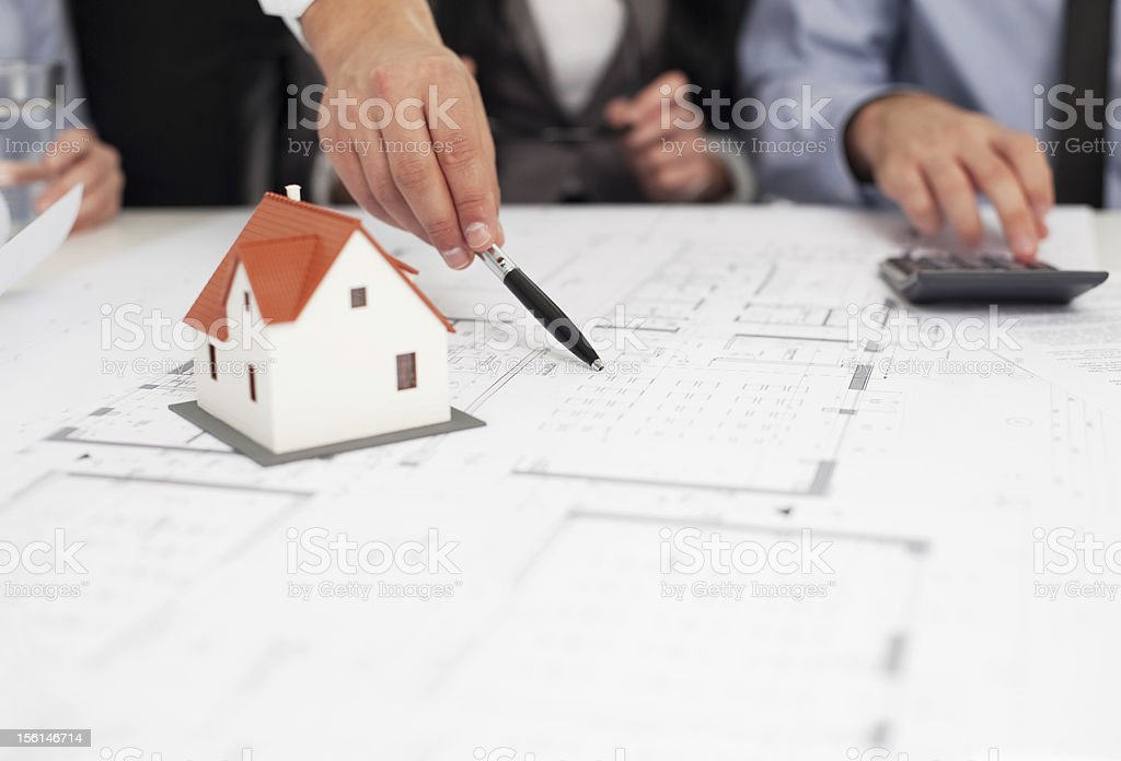 Pointing at blueprint Pointing at blueprint Advice Stock Photo