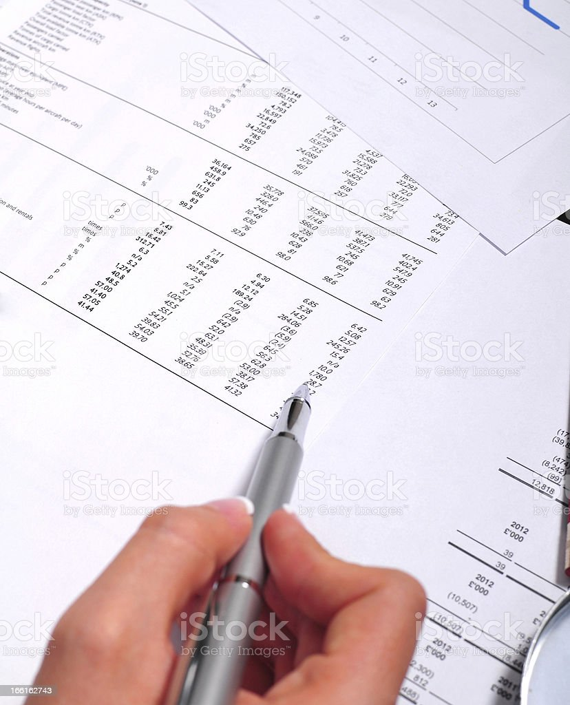 Pointing at the balance sheet royalty-free stock photo