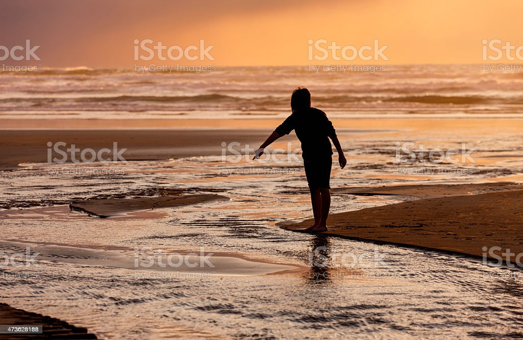 Pointing at the water during sunset. stock photo