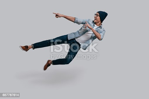 istock Pointing copy space in mid-air. 657787614