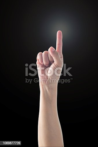 Pointing finger woman's hand with rim light isolated on black background (clipping path) for number one 1, showing direction, go straight forward, good ides