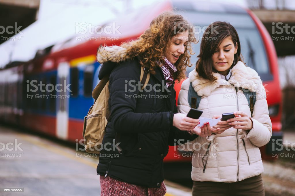 Pointing On Train Arrival On Phone royalty-free stock photo