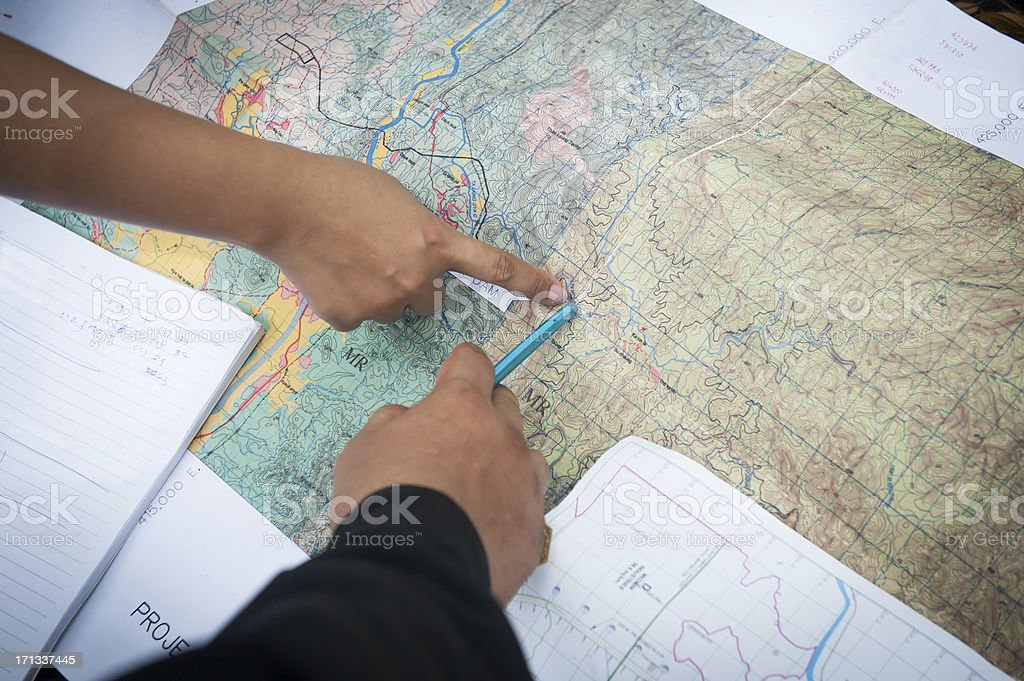 pointing out on map stock photo