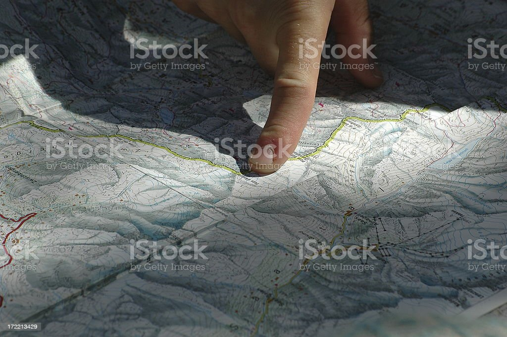 pointing out road on a map stock photo
