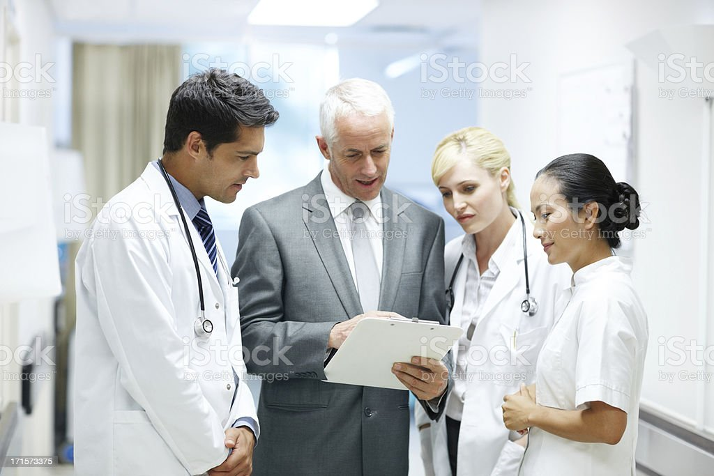Pointing out the importance of good patient care royalty-free stock photo