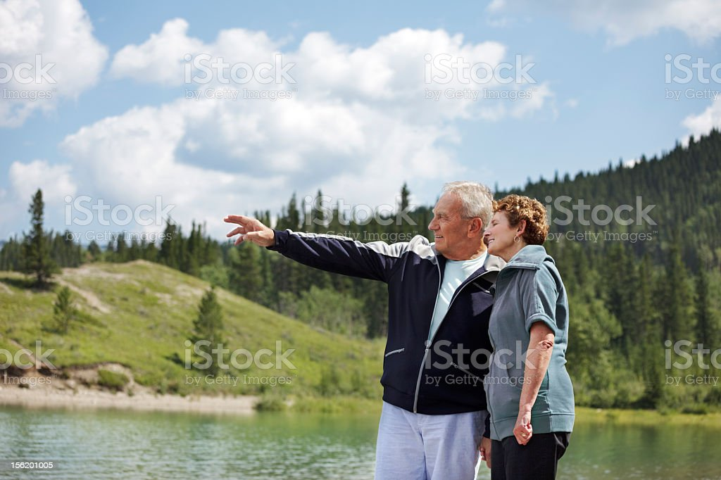 Pointing over the lake stock photo