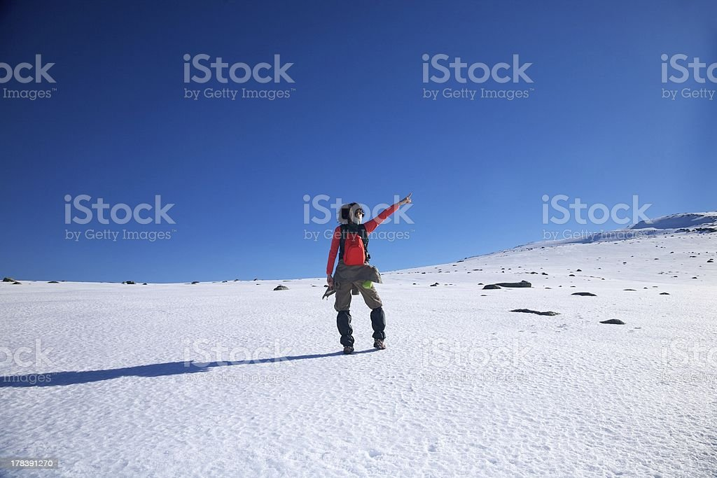 pointing red hiking woman stock photo