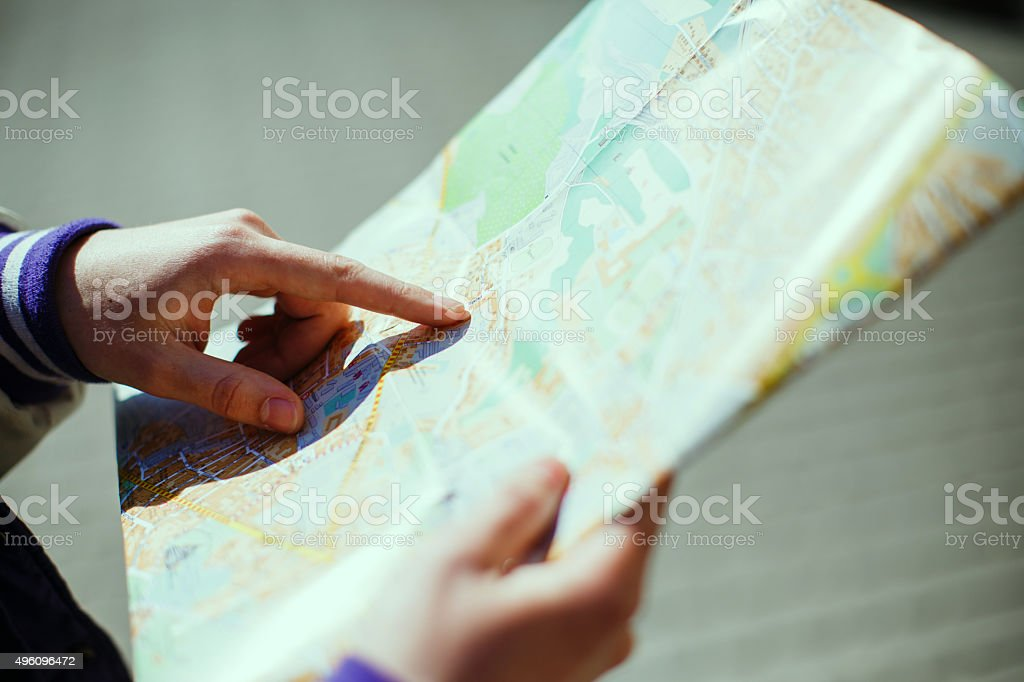Pointing the finger at a map stock photo