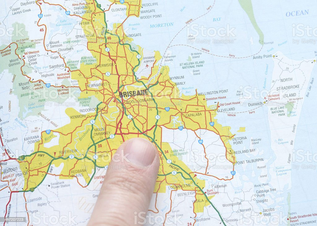 Pointing to Brisbane on the Map stock photo