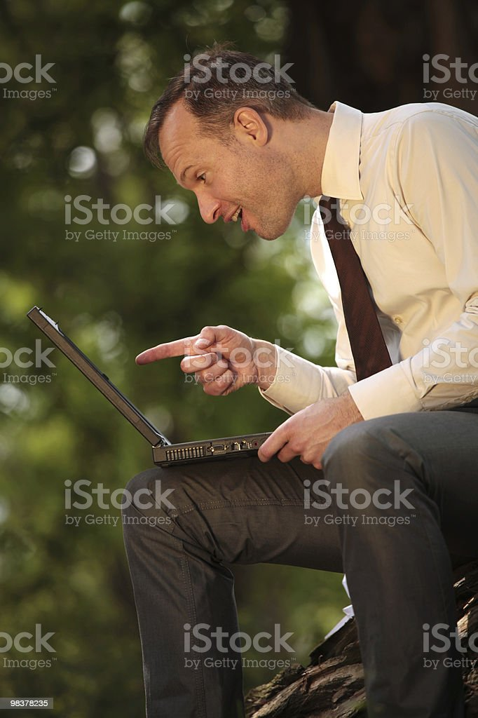 pointing with finger at laptop royalty-free stock photo