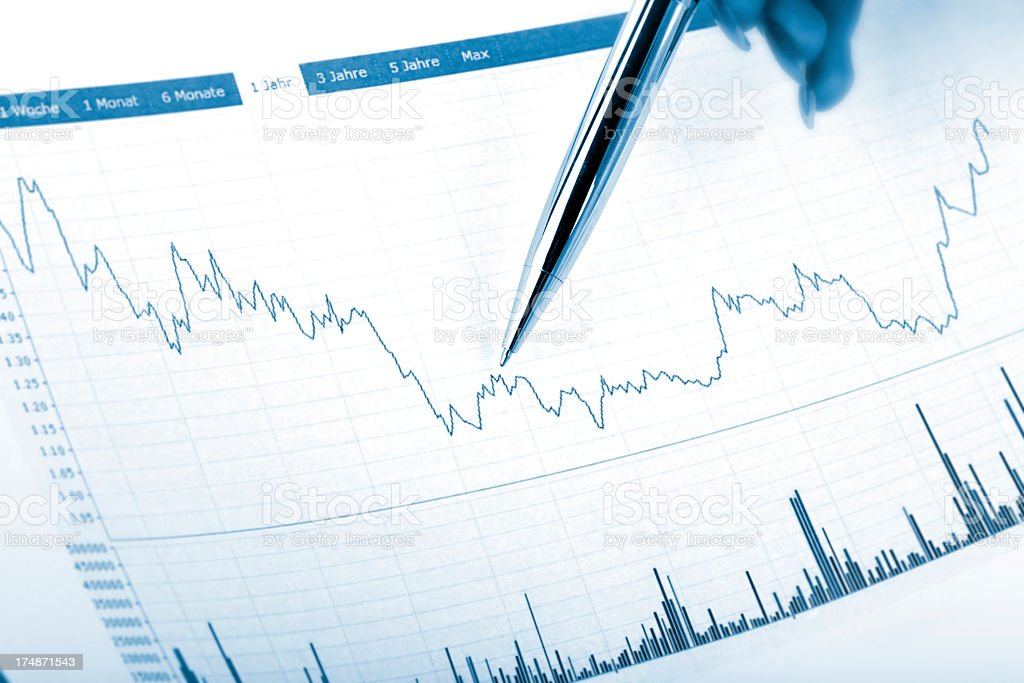 pointing with silver business pen on a chart document royalty-free stock photo