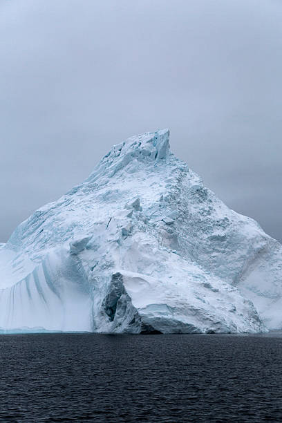 Pointy iceberg covered with snow stock photo