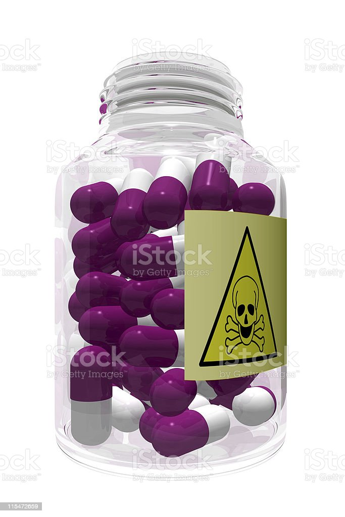 Poison pills in bottle royalty-free stock photo