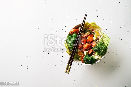 poke bowl with salmon islated on white background. top view