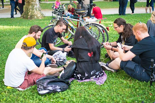 pokemon gathering in ljubljana park, slovenia - pflanzen pokemon stock-fotos und bilder