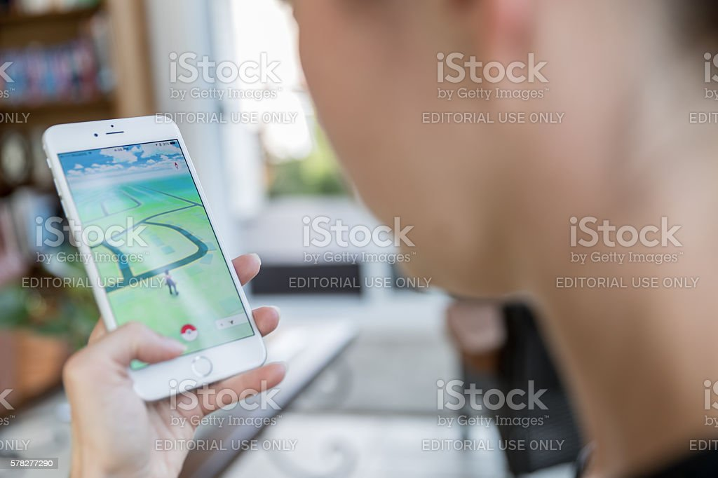 Pokemon Go App Being Played on iPhone 6 Plus royalty-free stock photo