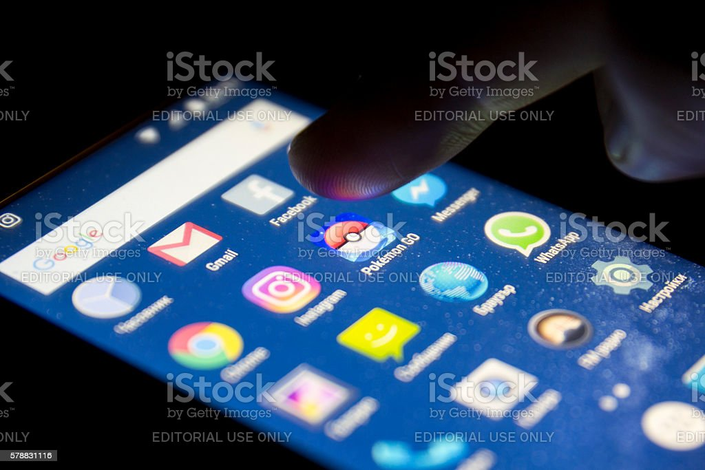 Pokemon Go game human hand stock photo
