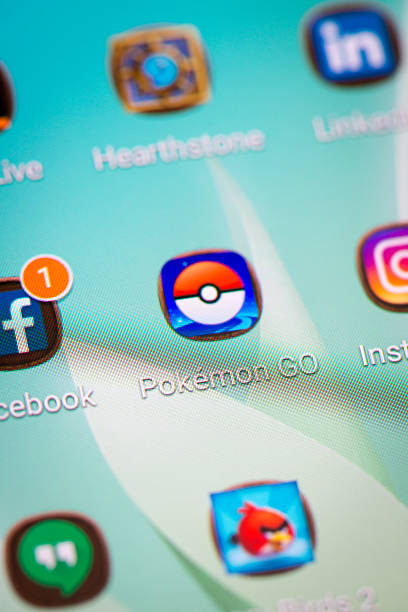 Pokemon Go icon macro closeup on Samsung smartphone screen stock photo