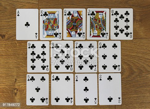 istock Poker cards clubs set two color classic design on wooden background 917849272