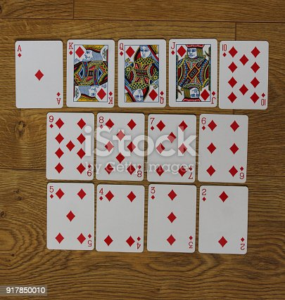 istock Poker cards diamond set two color classic design on wooden background 917850010