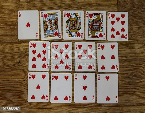 istock Poker cards hearts set two color classic design on wooden background 917852282