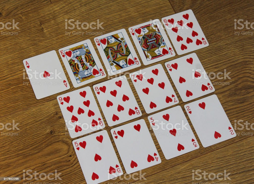 Poker cards hearts set two color classic design on wooden background stock photo