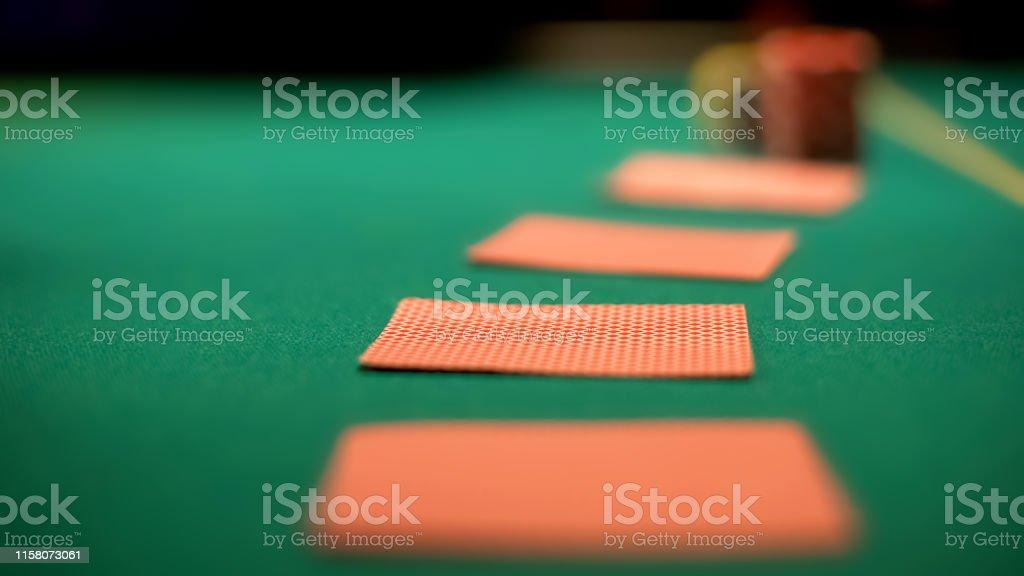 Poker cards lying on casino table, poker and blackjack casino games,...