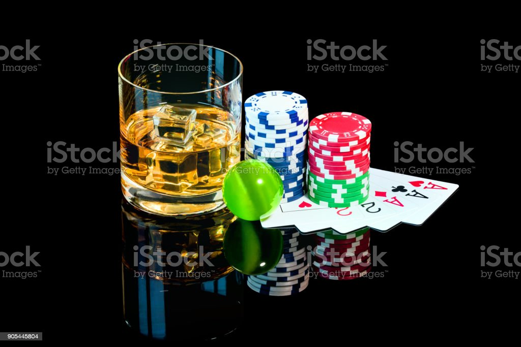 Poker Cards with color chips and the glass of whiskey stock photo
