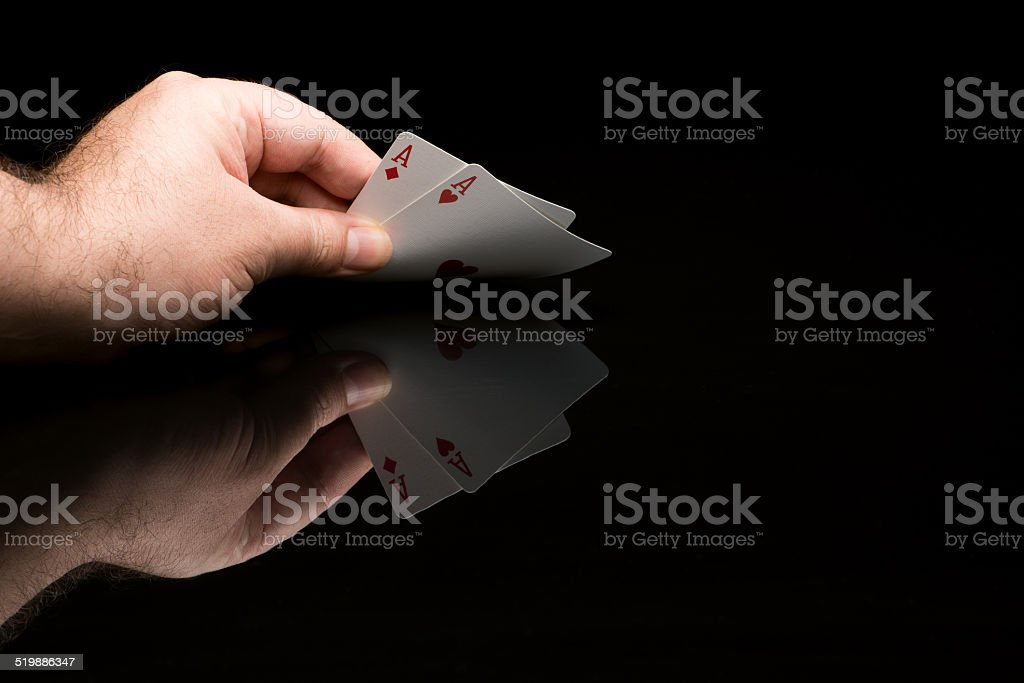 Poker cards with hand stock photo