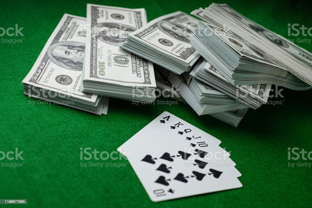 Poker Casino Gambling Royal Straight Flush And The Money Stack Of 100 Us Dollars Banknotes At The Green Background Stock Photo Download Image Now Istock