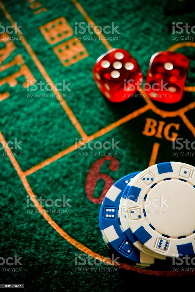 Poker Chips and Dice on Table royalty-free stock photo