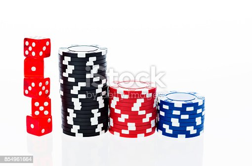 istock Poker chips and dice on white background 854961664