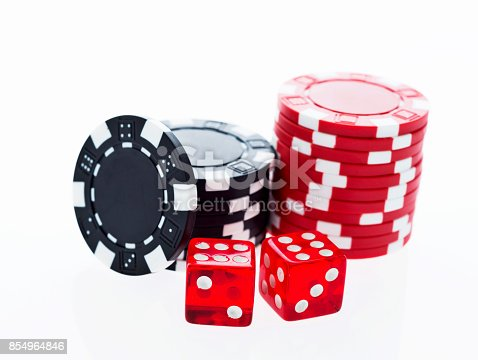 istock Poker chips and dice on white background 854964846