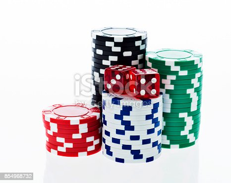 istock Poker chips and dice on white background 854968732