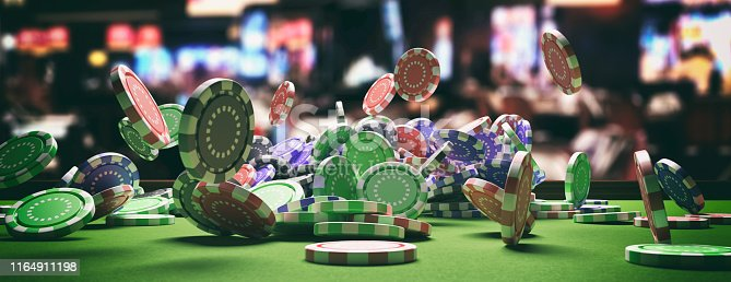 Casino poker concept. Poker chips falling on green felt roulette table, blur casino interior background, banner. 3d illustration