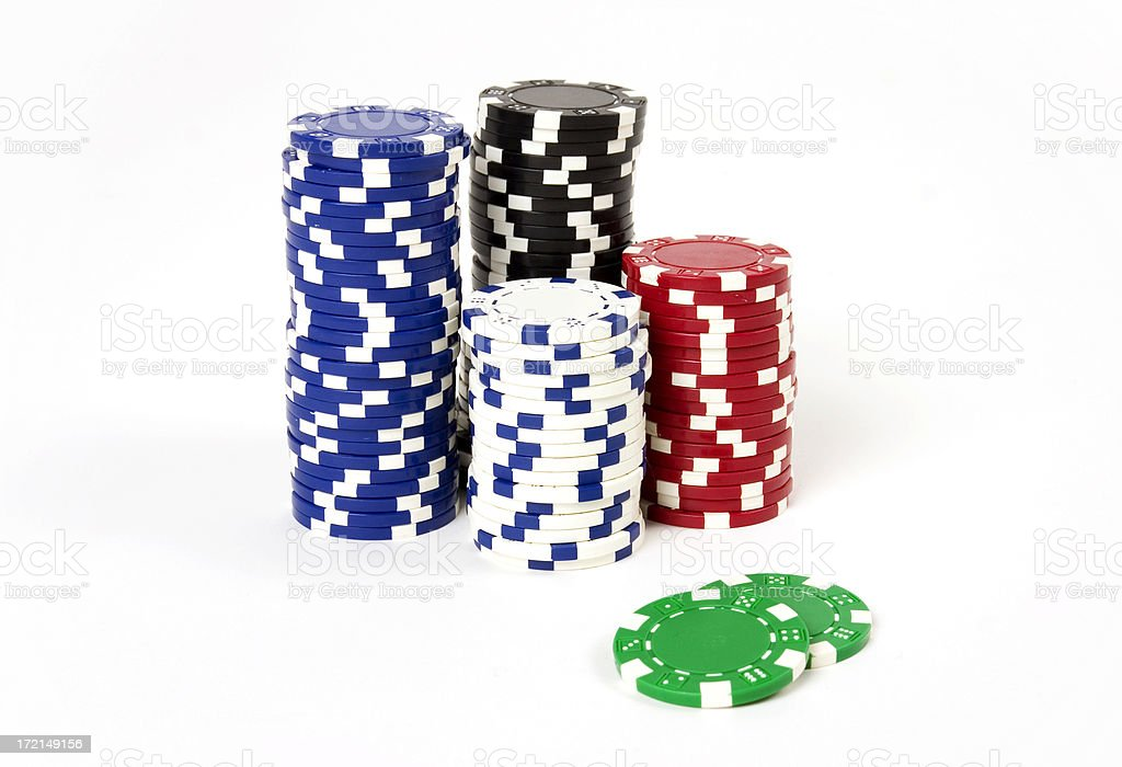 Poker chips of every color standing together stock photo