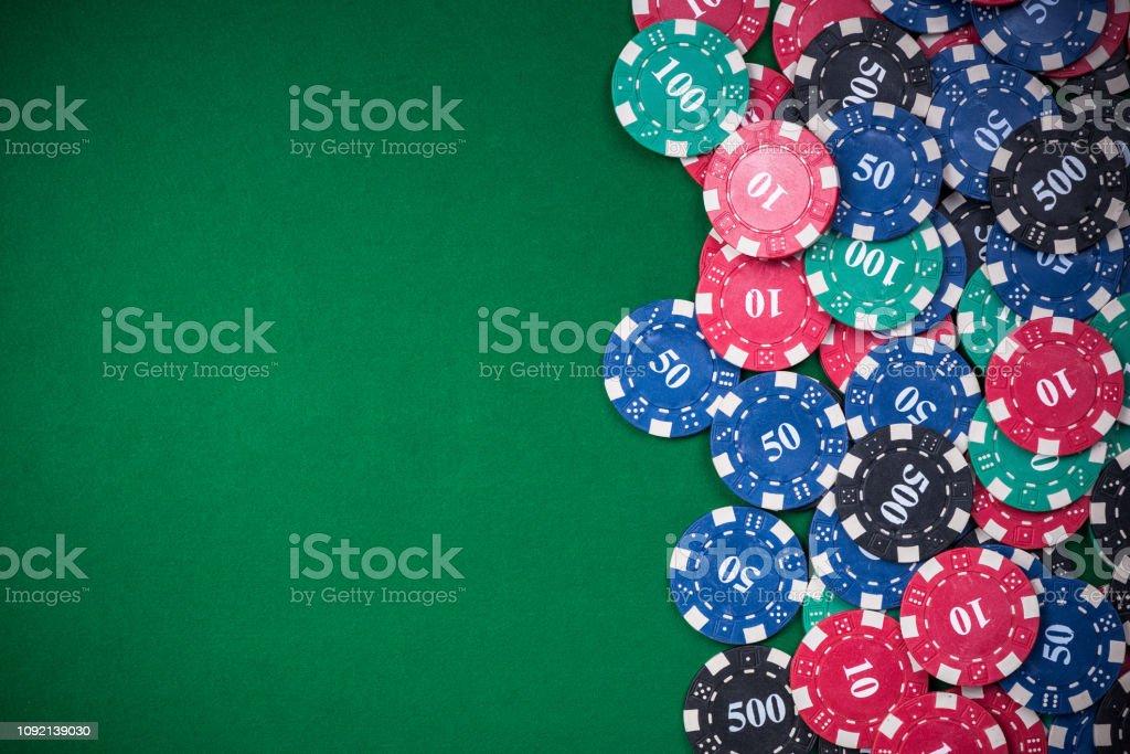 poker chips on green casino table, border background.