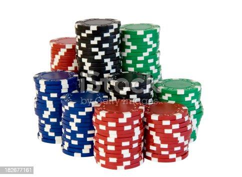 Stacks of poker or blackjack chips isolated on white.