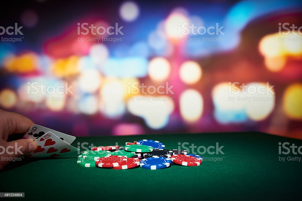 Poker chips with pair of cards stock photo