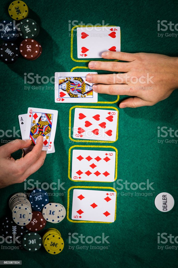 Poker concept with cards on green table. Hand-ranking categories: One-pair royalty-free stock photo