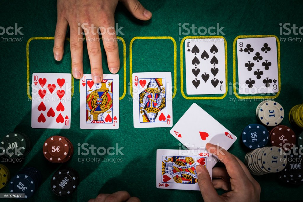 Poker concept with cards on green table. Hand-ranking categories: Royal Flush royalty-free stock photo