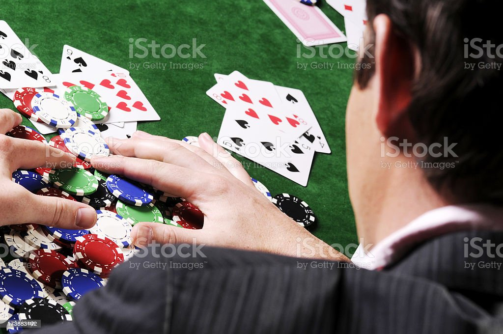 Poker Game Series: Pulling in the Chips royalty-free stock photo