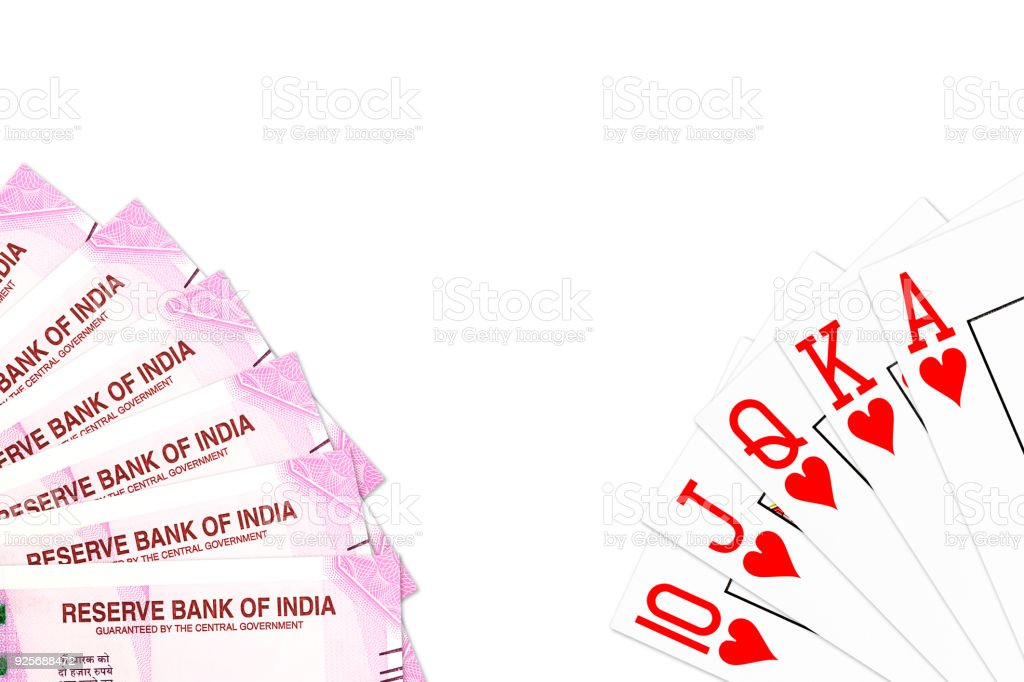 poker hand royal flush in hearts and 2000 indian rupee bank notes isolated on white background stock photo
