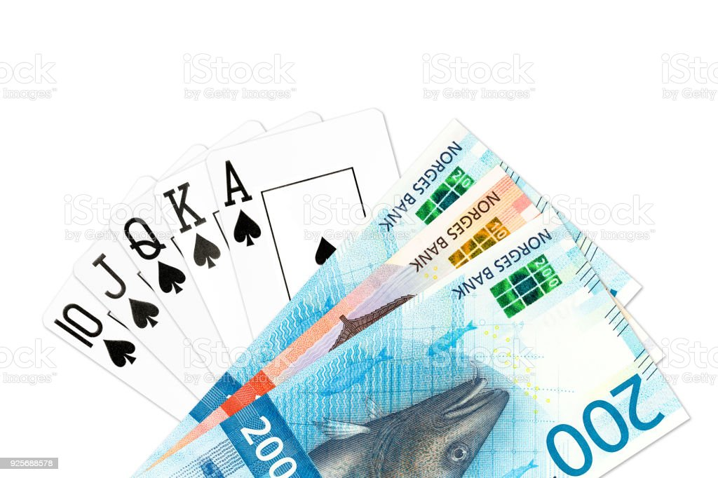 poker hand royal flush in spades and some norwegian krone bank notes isolated on white background stock photo