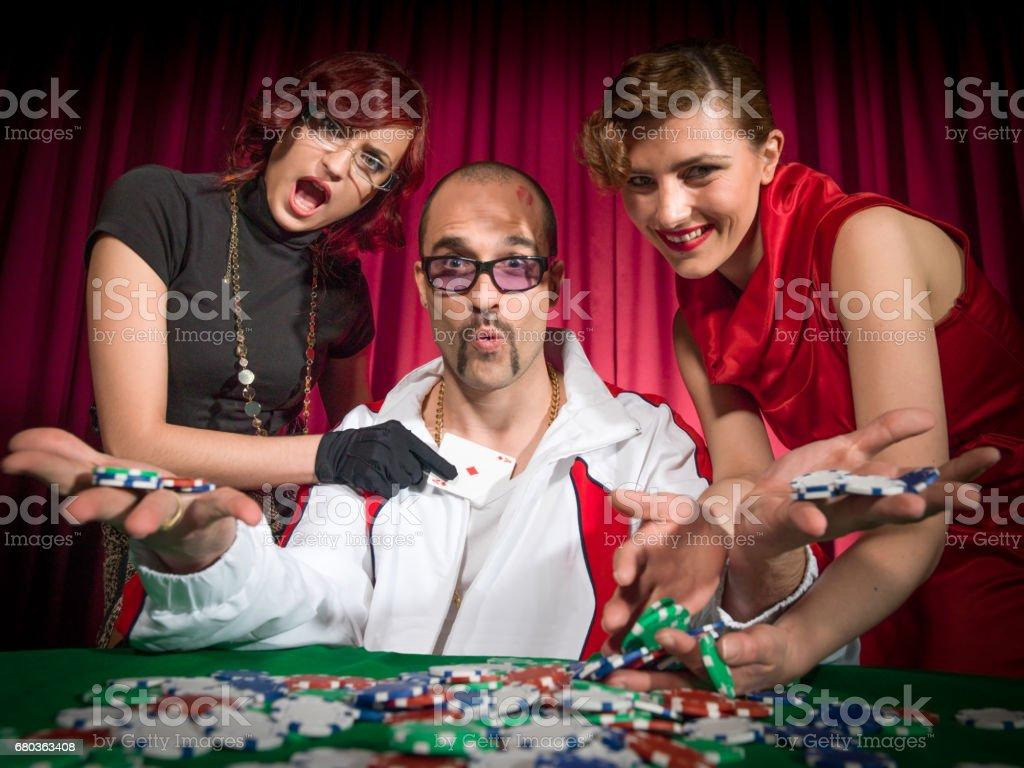 Poker Pimp at the Casino Gambling Table stock photo