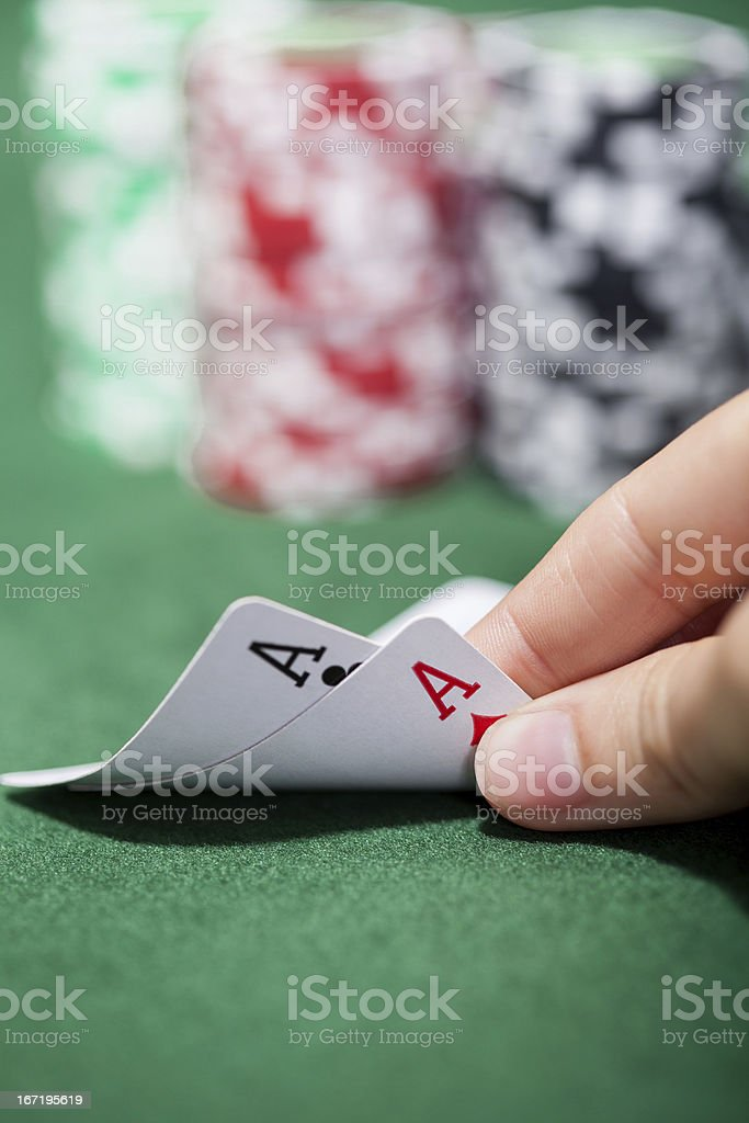 Poker player checking a pair of aces royalty-free stock photo