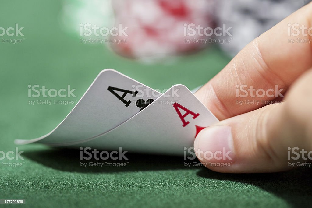 Poker player checking a pair of aces stock photo