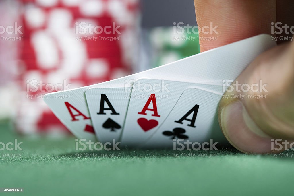 Poker player holding playing cards stock photo